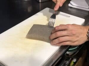 How to make Doteyaki: Scoring konjac with a metal fork