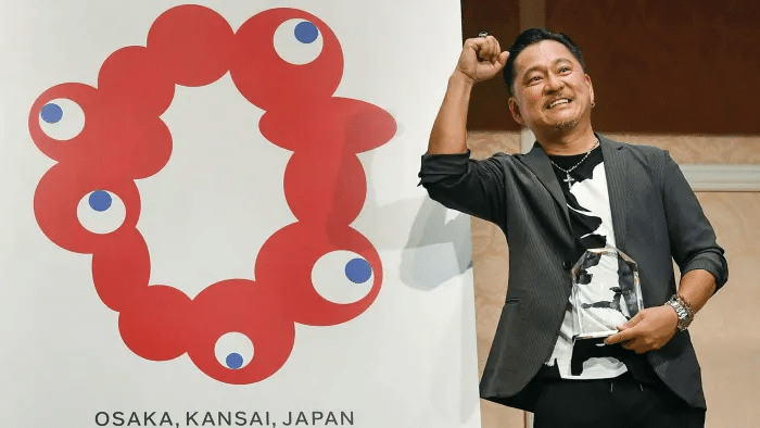 Artist Shimada Tamotsu at the unveiling of the Expo 2025 logo. Source: Financial Times https://www.ft.com/content/14fb8242-89f0-4090-b67e-deea4c918b2b