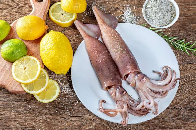 Seasoned squid ready to be grilled