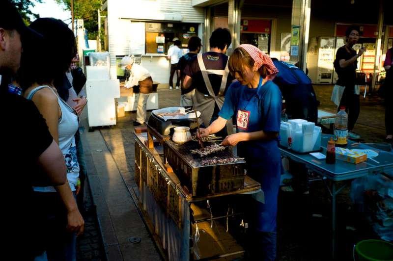 Street vendor selling fresh grilled Ikayaki